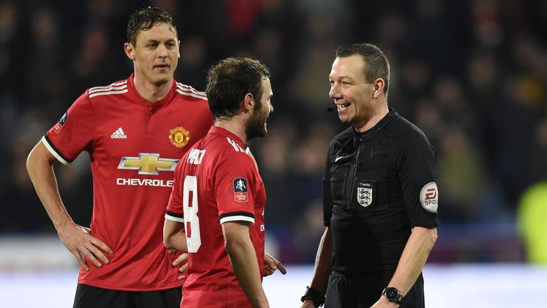 English referee Kevin Friend (R) chats with Manchester United's Spanish midfielder Juan Mata during the English FA Cup fifth round football match between H