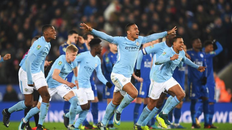 LEICESTER, ENGLAND - DECEMBER 19:  Danilo of Manchester City and team mates celebrate shoot out victory during the Carabao Cup Quarter-Final match between