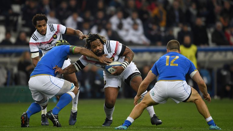 MARSEILLE, FRANCE - FEBRUARY 23:  Mathieu Bastareaud of France is tackled by Maxime Mbanda and Tommaso Castello of Italy during the NatWest Six Nations mat