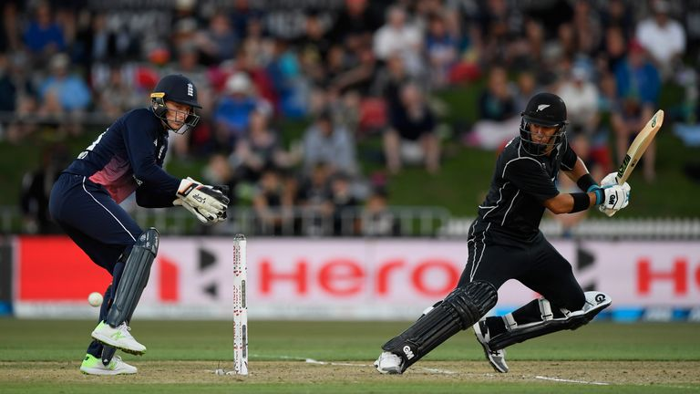 Jos Buttler looks on as New Zealand batsman Ross Taylor picks up some runs during the 1st ODI between New Zealand and England