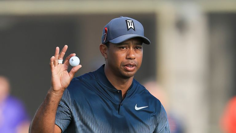 PALM BEACH GARDENS, FL - FEBRUARY 22:  Tiger Woods reacts after a putt on the 14th hole during the first round of the Honda Classic at PGA National Resort