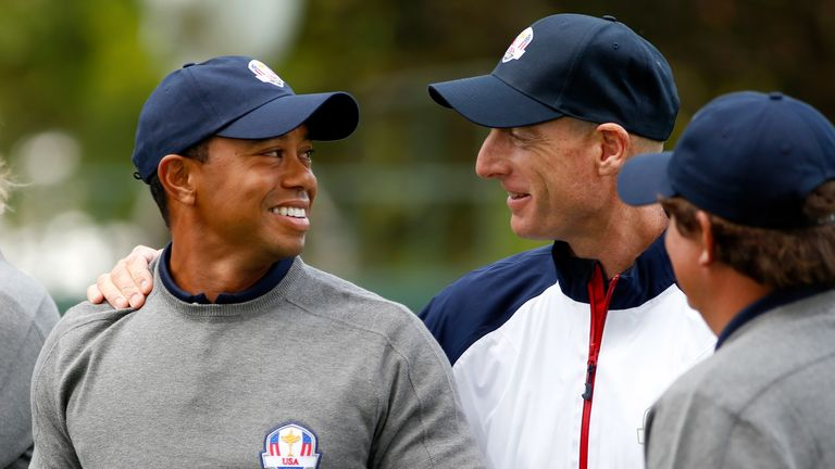 MEDINAH, IL - SEPTEMBER 25:  Tiger Woods talks with Jim Furyk during the USA team photocall during the second preview day of The 39th Ryder Cup at Medinah