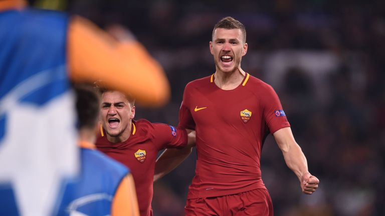 Edin Dzeko celebrates after scoring for Roma