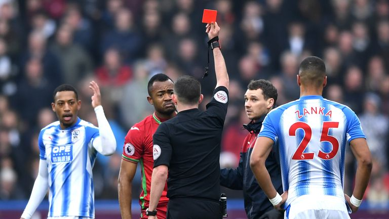 Jordan Ayew is shown a red card after just 11 minutes