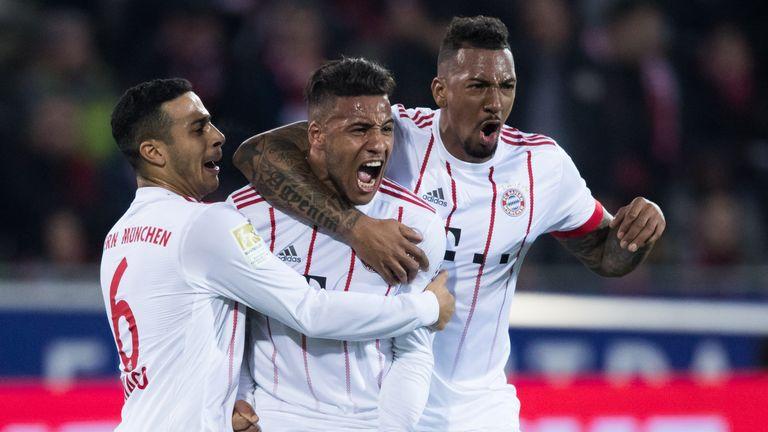 Bayern Munich's Corentin Tolisso (C) celebrates scoring against Freiburg