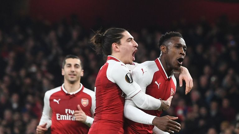 Danny Welbeck was on song as the Gunners knocked out AC Milan in the round-of-16