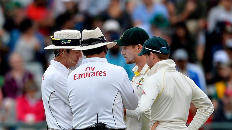 Cameron Bancroft and Steven Smith (right) chatting with the umpires during the controversial Test against South Africa at Newlands
