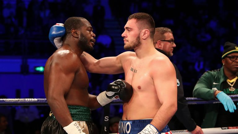 Allen is consoled by Thomas after the fight was halted