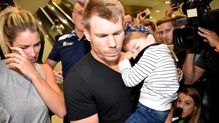 David Warner (C) and his wife Candice after his arrival in Sydney on Thursday