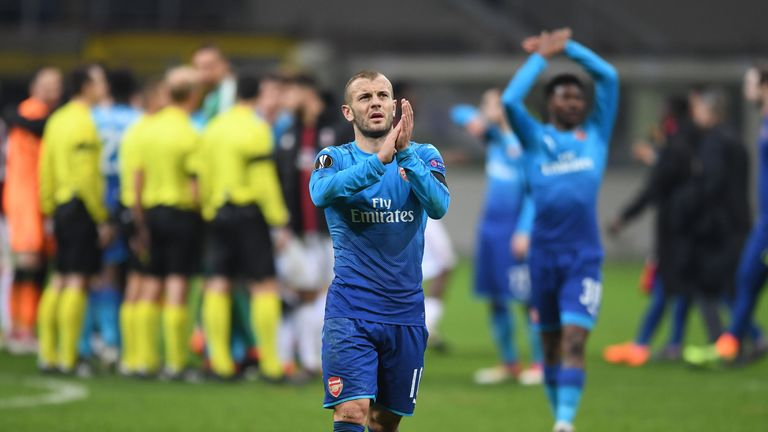 Jack Wilshere applauds the travelling fans after Arsenal's 2-0 win at AC Milan