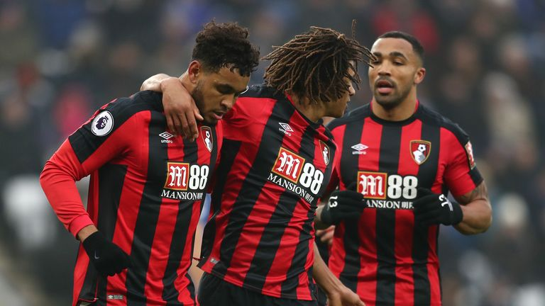Joshua King (left) is congratulated by Nathan Ake and Callum Wilson after opening  the scoring at the King Power