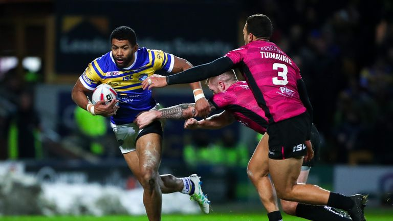 Leeds' Kallum Watkins is tackled by Hull FC's Marc Sneyd.