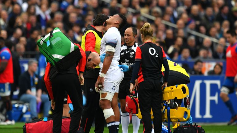 Nathan Hughes of England goes off injured against France