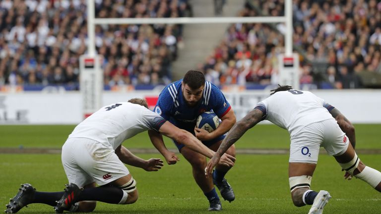 Prop Rabah Slimani takes on the England defence