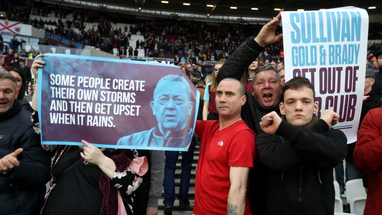 West Ham fans protest during the game against Burnley