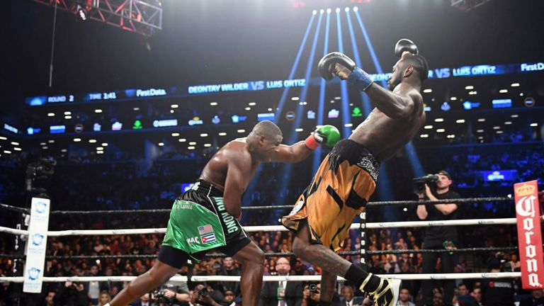 Ortiz knocks back Wilder during Sunday's fight at the Barclays Centre, New York