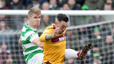 Celtic's Kristoffer Ajer (L) challenges with Ryan Bowman