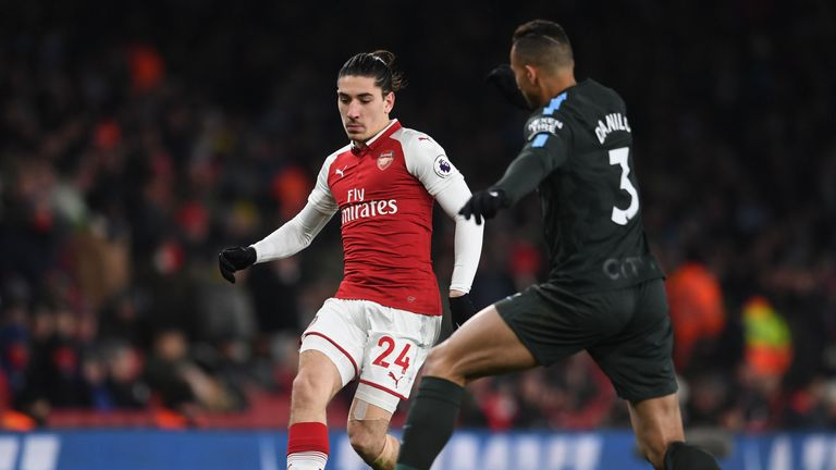 Hector Bellerin passes under pressure from Danilo during the Premier League match between Arsenal and Manchester City at Emirates Stadium on March 1, 2018