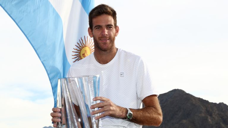 Juan Martin del Potro of Argentina poses with the winner's trophy after defeating Roger Federer of Switzerland during the men's final on Day 14 of the BNP Paribas Open at the Indian Wells Tennis Garden on March 18, 2018 in Indian Wells, California.