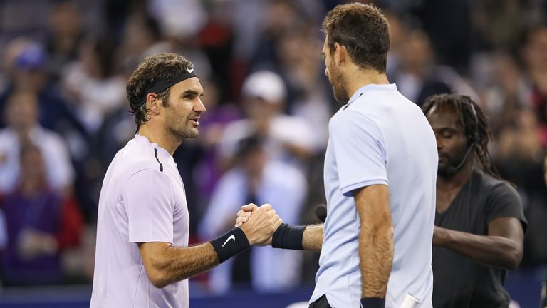 Roger Federer of Switzerland is congratulated by Juan Martin del Potro of Argentina after winning the Men's singles Semifinal mach on day seven of 2017 ATP Shanghai Rolex Masters at Qizhong Stadium on October 14, 2017 in Shanghai, China.
