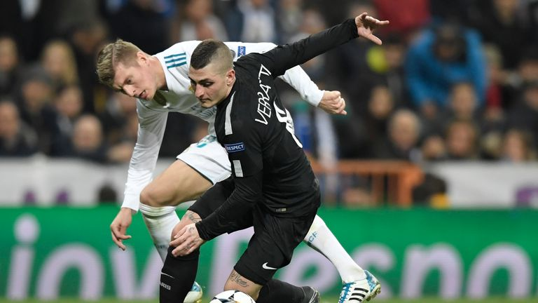 Toni Kroos and Marco Verratti (right) battle for the ball