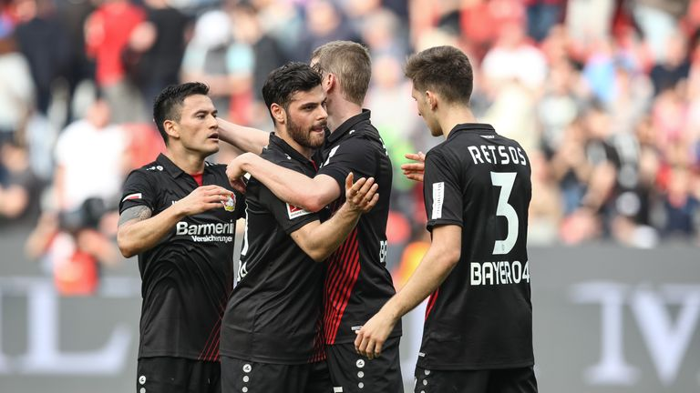 Kevin Volland celebrates after scoring for Bayer Leverkusen