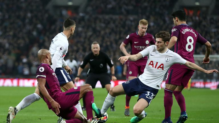 Ben Davies picked up a booking for this challenge on Vincent Kompany