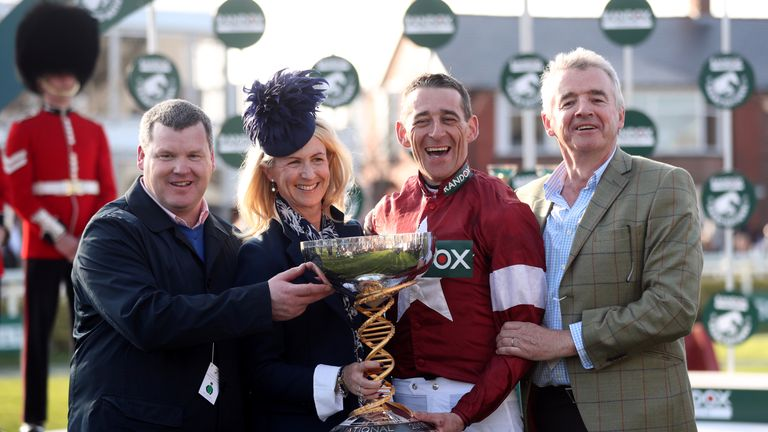 Winning jockey Davy Russell, owner Michael O'Leary (right), trainer Gordon Elliott (left) and Anita O'Leary after winning the Grand National with Tiger Roll