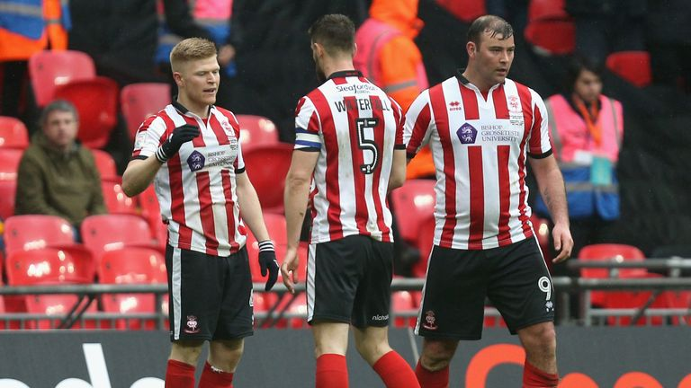 Lincoln City celebrate their opening goal in this year's final
