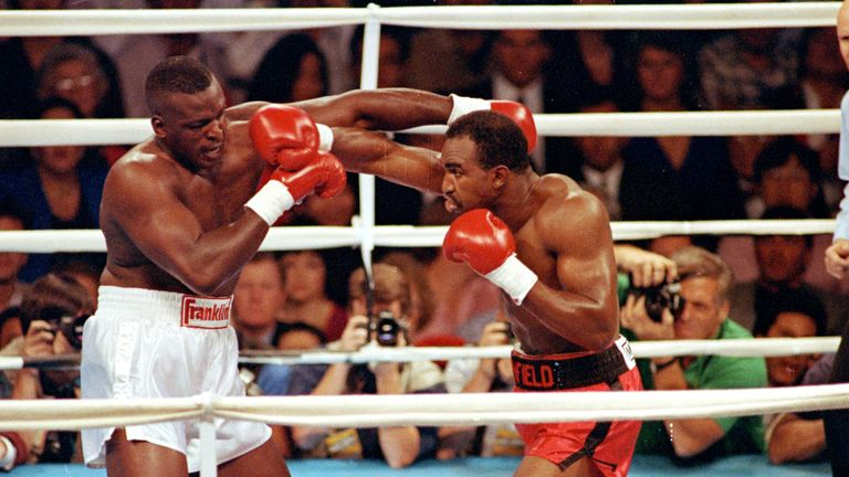 Holyfield (R) stopped Douglas to create history in 1990