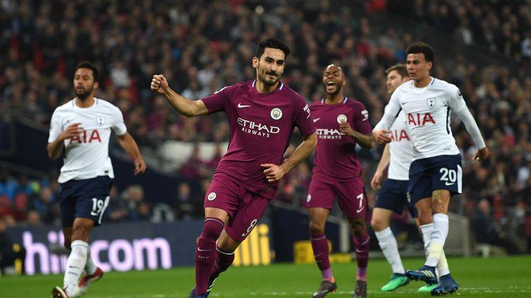 Ilkay Gundogan wheels away after doubling City's lead from the penalty spot