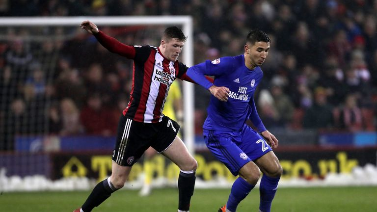 Sheffield United's John Lundstram (left) and Cardiff's Marko Grujic battle for the ball