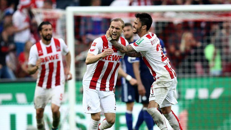 Marcel Risse celebrates his late goal for Cologne against Schalke