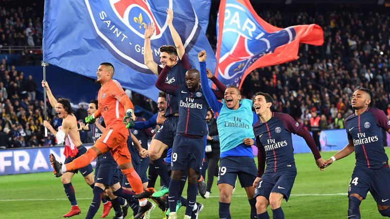 PSG players celebrate with their fans