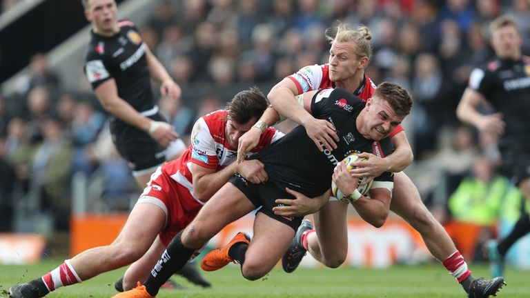 Henry Slade is tackled by Gloucester's Stuart Townsend and Mark Atkinson