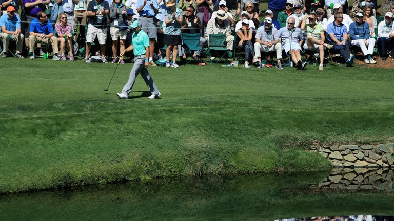 In the drink! Day sends shot into fan's beer cup at Masters