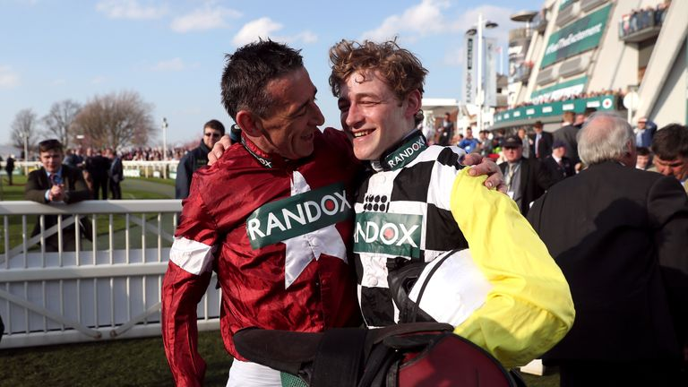 Russell (left) and Pleasant Company's jockey David Mullins after finishing first and second respectively at Aintree