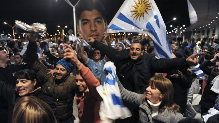 Adoring fans welcome Suarez back in Uruguay after being sent home from the World Cup