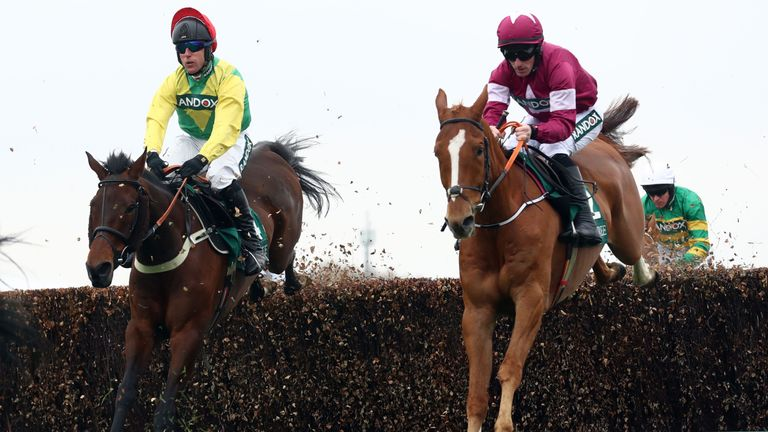 Finian's Oscar (left) on his way to victory at Aintree