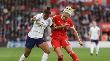 England's Nikita Parris (left) is challenged by Charlotte Estcourt of Wales