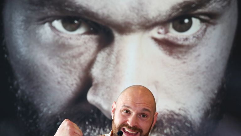 Tyson Fury addresses the media during a press conference at the Lowry Hotel in Manchester on April 26, 2018