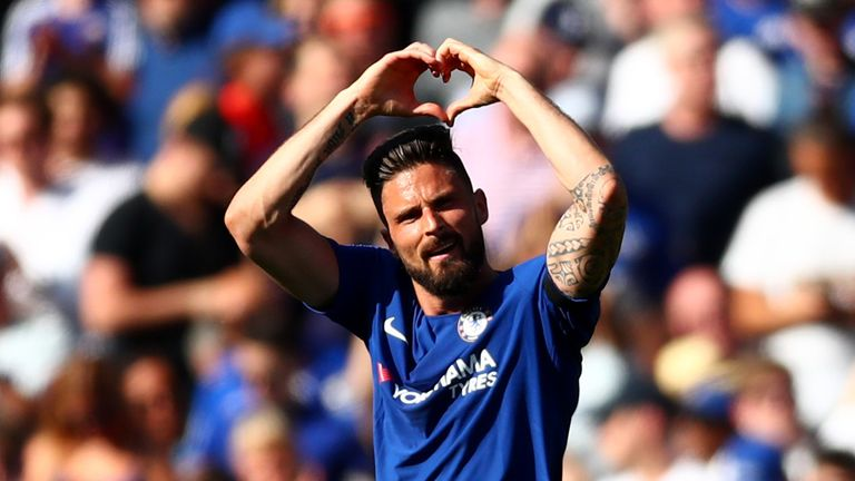 Olivier Giroud salutes the fans after opening the scoring at Stamford Bridge