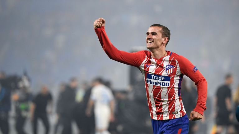 The France international celebrates his first major trophy after four years at Atletico