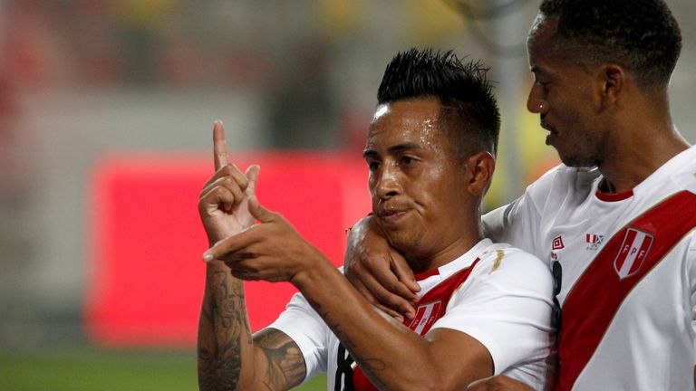 Christian Cueva celebrates after scoring for Peru against Scotland