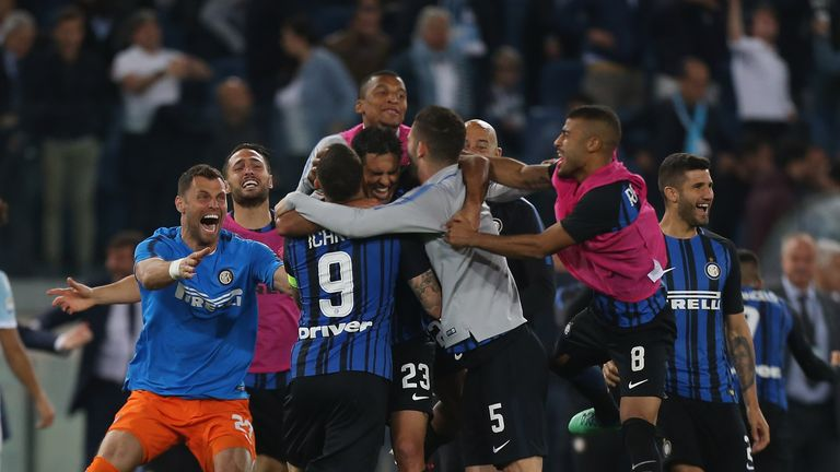 Inter Milan players celebrate after qualifying for the Champions League