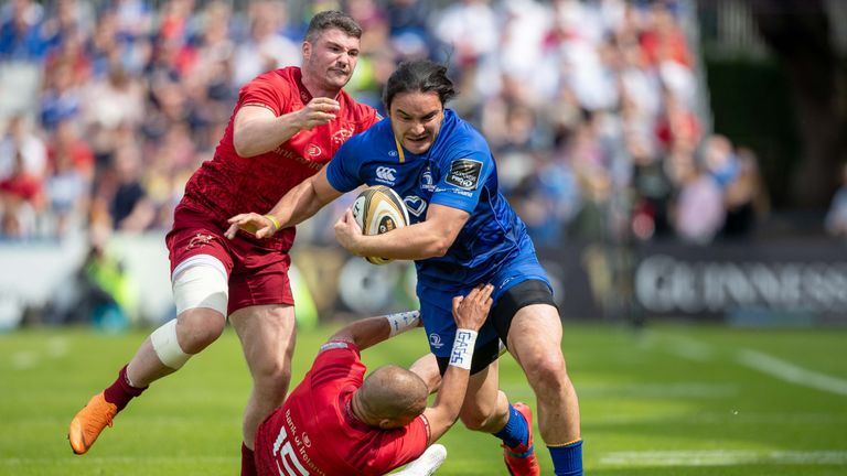 Man-of-the-match James Lowe looks to get past Munster's Sammy Arnold and Simon Zebo