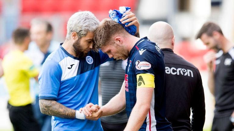 Ross County's Jason Naismith is consoled by St Johnstone's Richard Foster