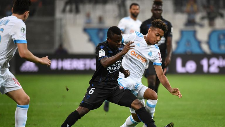 Seri tackles Boubacar Kamara of Marseille