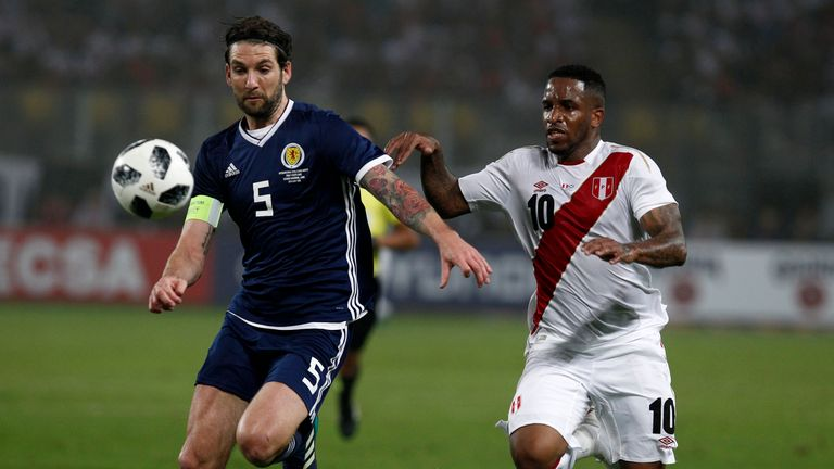 Goalscorer Jefferson Farfan goes up against Charlie Mulgrew during the game