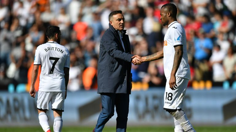 Jordan Ayew and Carlos Carvalhal shake hands at the final whistle as Swansea City are relegated
